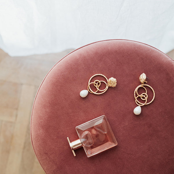 Jewelry on Ottoman after being Cleaned with Non-Toxic Cleaner